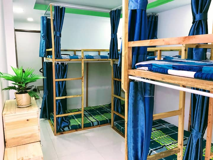 Dorm in heart of city with green balcony