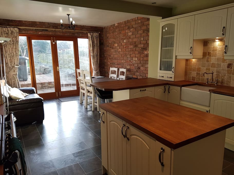 Large Kitchen Dining Room opening onto garden