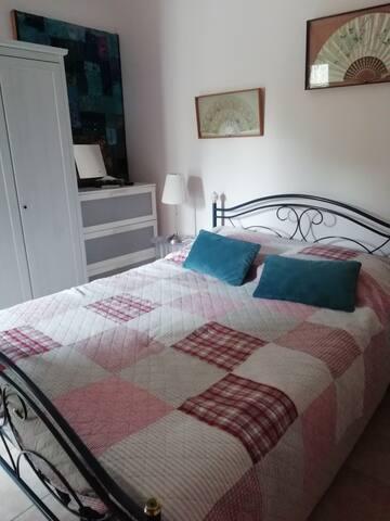 Poppy bedroom, double bed, aircon, juliet balcony overlooking rear garden