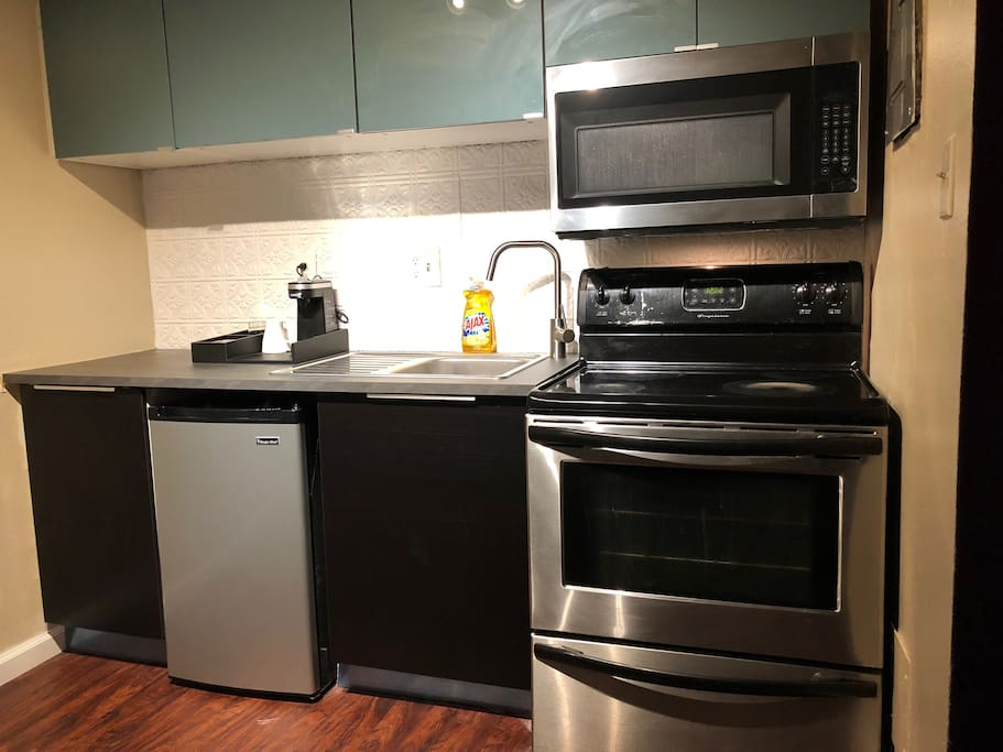 Full kitchen with dishware provided + K-Cup coffee maker.