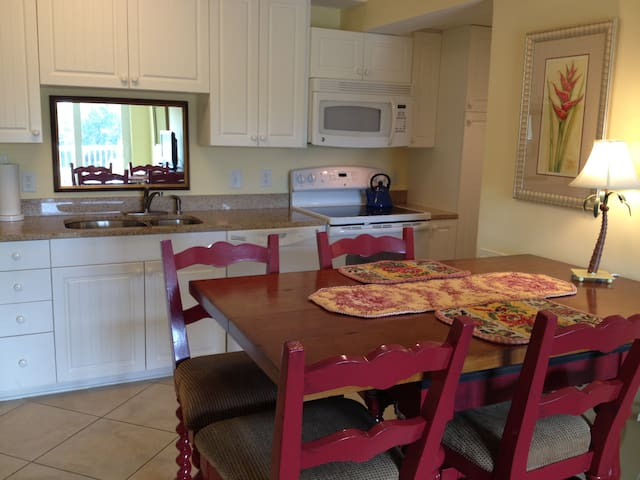 Kitchen with granite counters and pub table