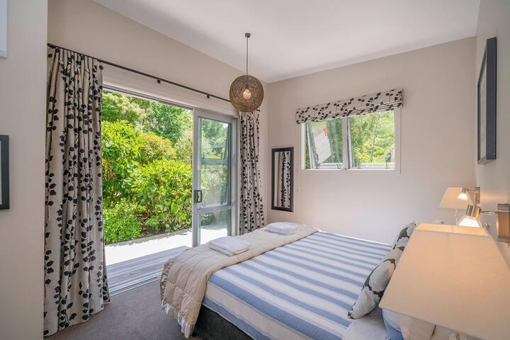 Bedroom 2 with sliding doors onto deck area