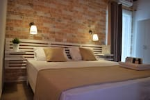 """<i class=""""slide-italic-text"""">Beautiful</i> Rooms The Coast offers 5 Deluxe rooms fully equipped with everything  <br /> you need for relaxing and delightful holidays"""