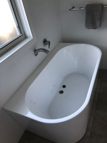 Beautiful new Caroma back to the wall freestanding bath.