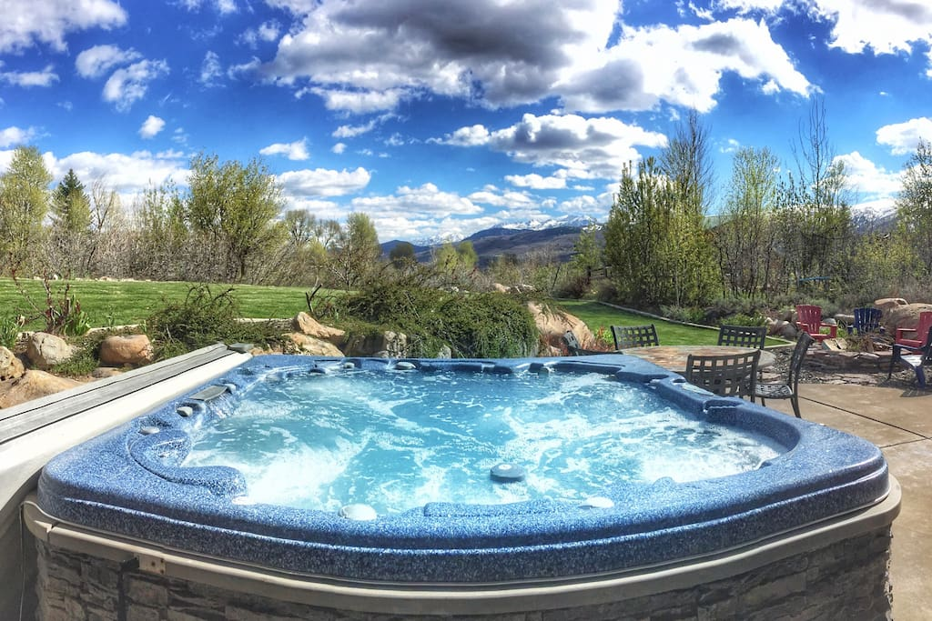 Private hot tub on back patio with fire pit and large private yard. Amazing views of Snowbasin and Nordic Valley.