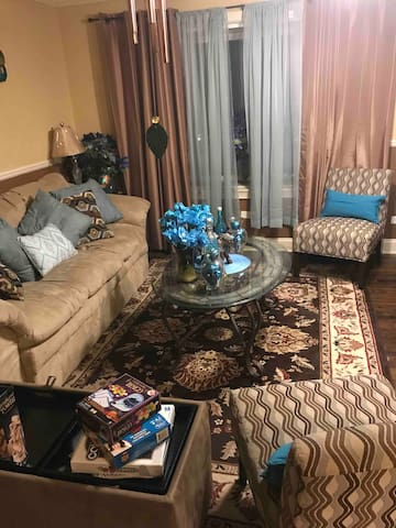 This is our family room/living room. It is equipped with beautiful lighting and entertainment for your family.