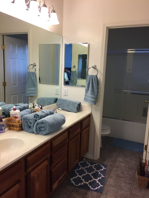 The en suite master bathroom has dual sinks and a privacy door for toilet and shower/bathtub.