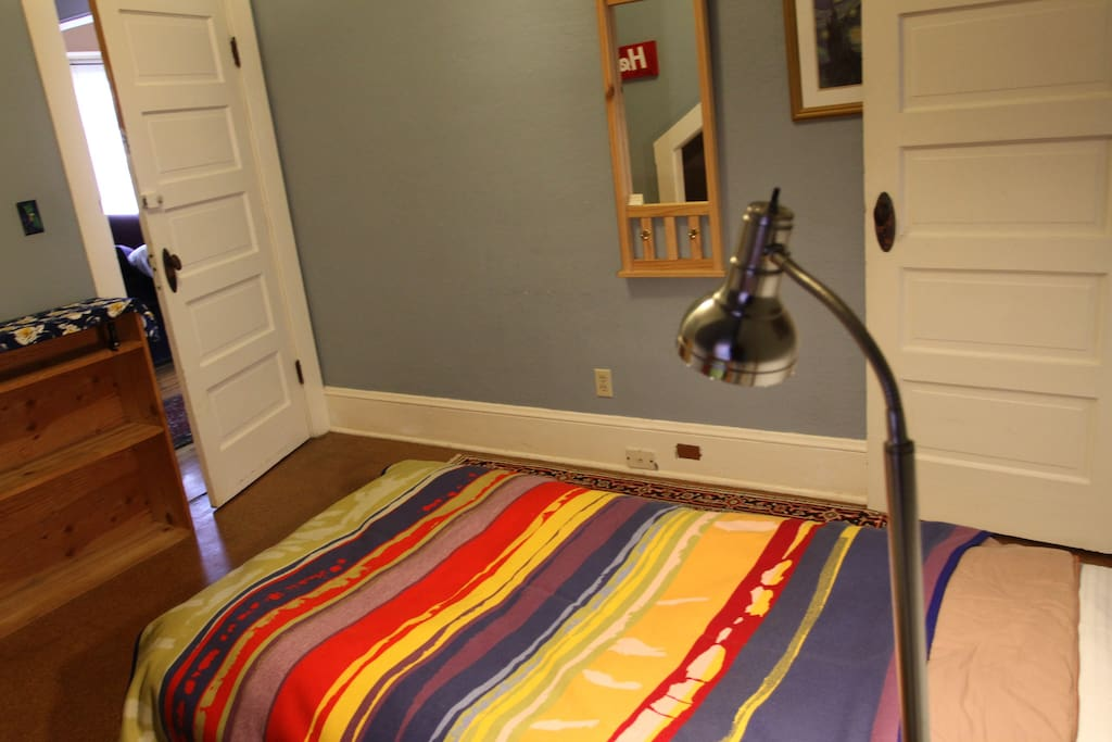 Cozy and comfortable space with a Pendleton blanket over comforter
