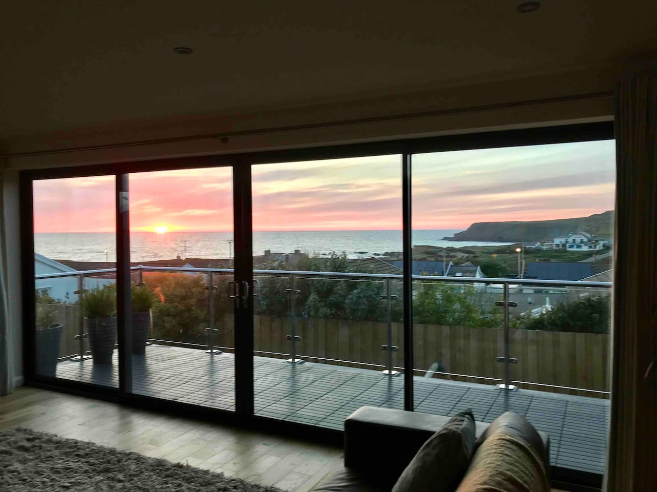 Baywatch Widemouth Bay - Take in the sunset views of an evening from the sofa