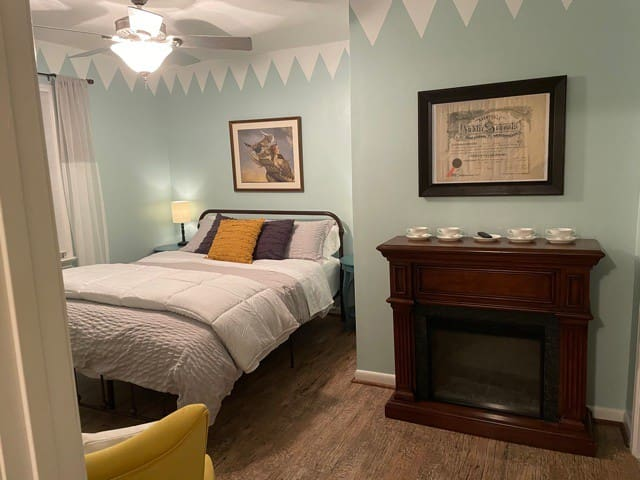 Tucked under the main house stairwell, this quiet bedroom space is tranquil, cool and relaxing. Winter visitors can enjoy an electronic fireplace that makes this special little retreat extra warm and cozy!