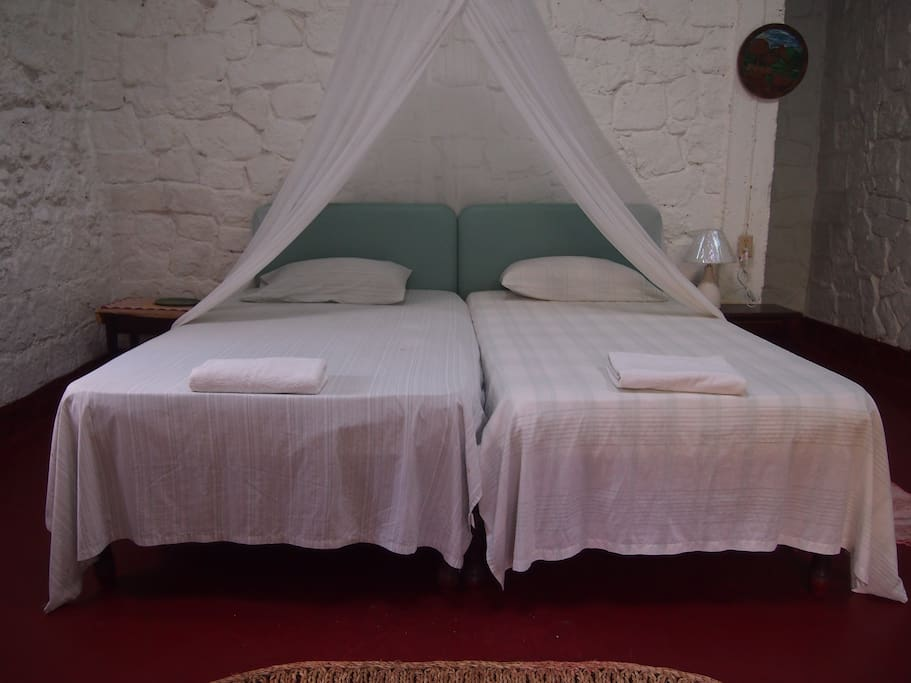 2-Twin beds located inside the double room.