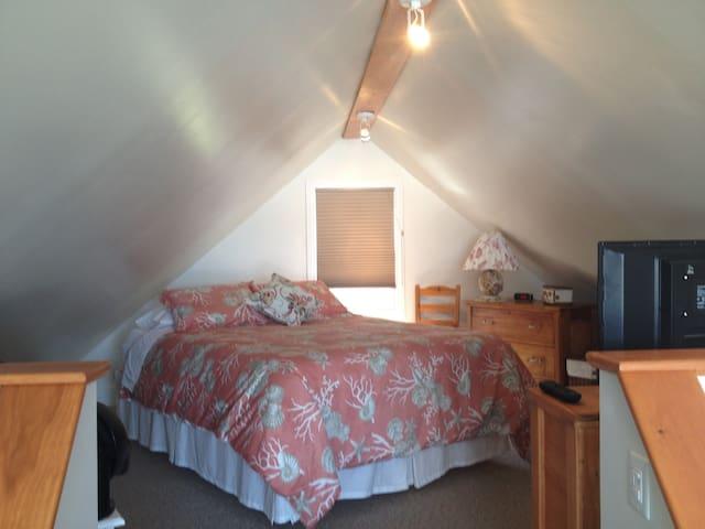 Loft bedroom with queen size memory foam mattress