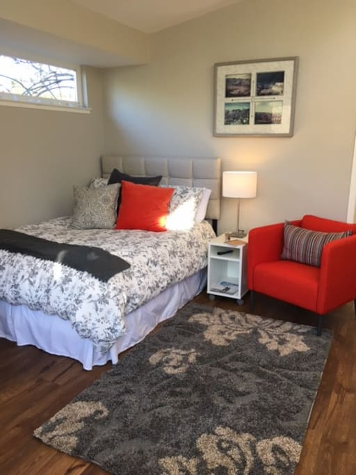 Double size bed and reading chair with great lighting
