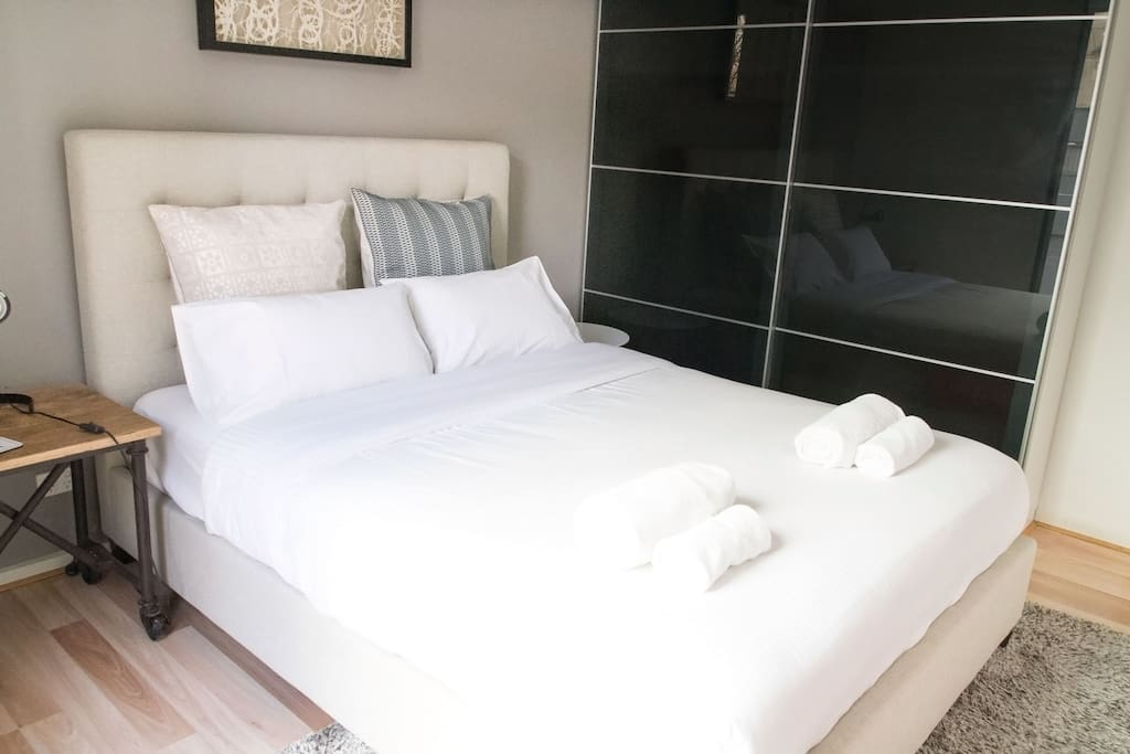 Luxurious queen size bed with hotel quality linens