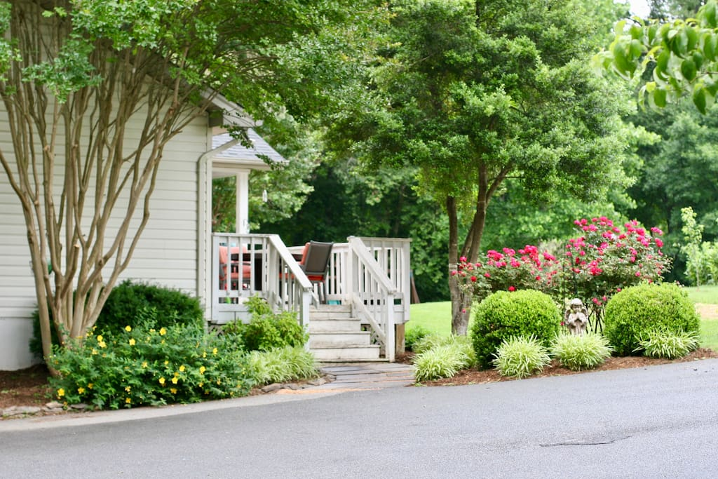 House is surrounded by lovely gardens and offers a serene outdoor space for BBQ's or a perfect place for children to play.