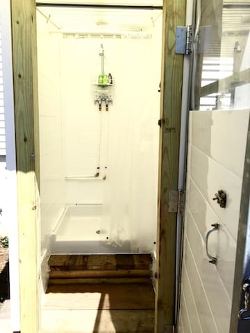 Enclosed hot and cold outdoor shower just steps away. Shampoo, conditioner and body wash provided.