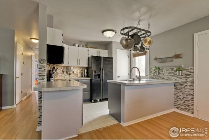 Shared Kitchen.  Equipped with appliances, cookware, dishes, complementary  snacks and drinks.