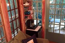 Keurig coffee maker, glassware, and mini fridge.