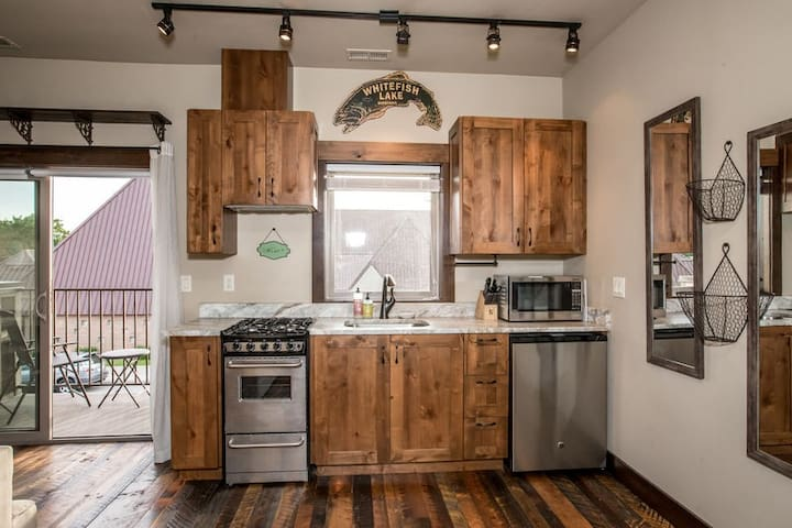 Downtown Whitefish condo with huge views of Big Mountain from the deck !!