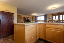 Roomy open living area with kitchen/living/dining.  It's a 1000-square-foot apartment.  No shared space, it's all yours!