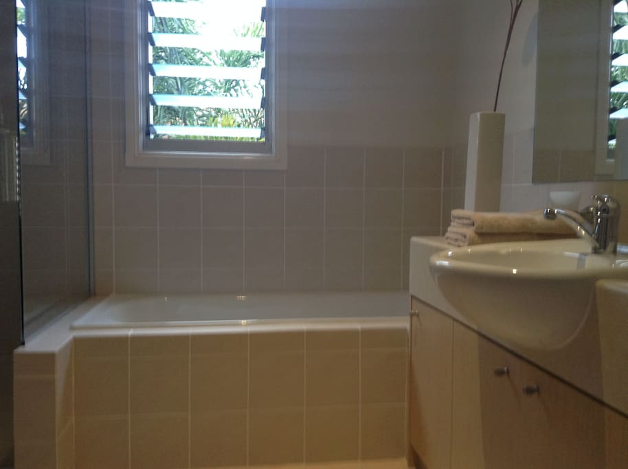 Private bathroom with tub and separate large shower