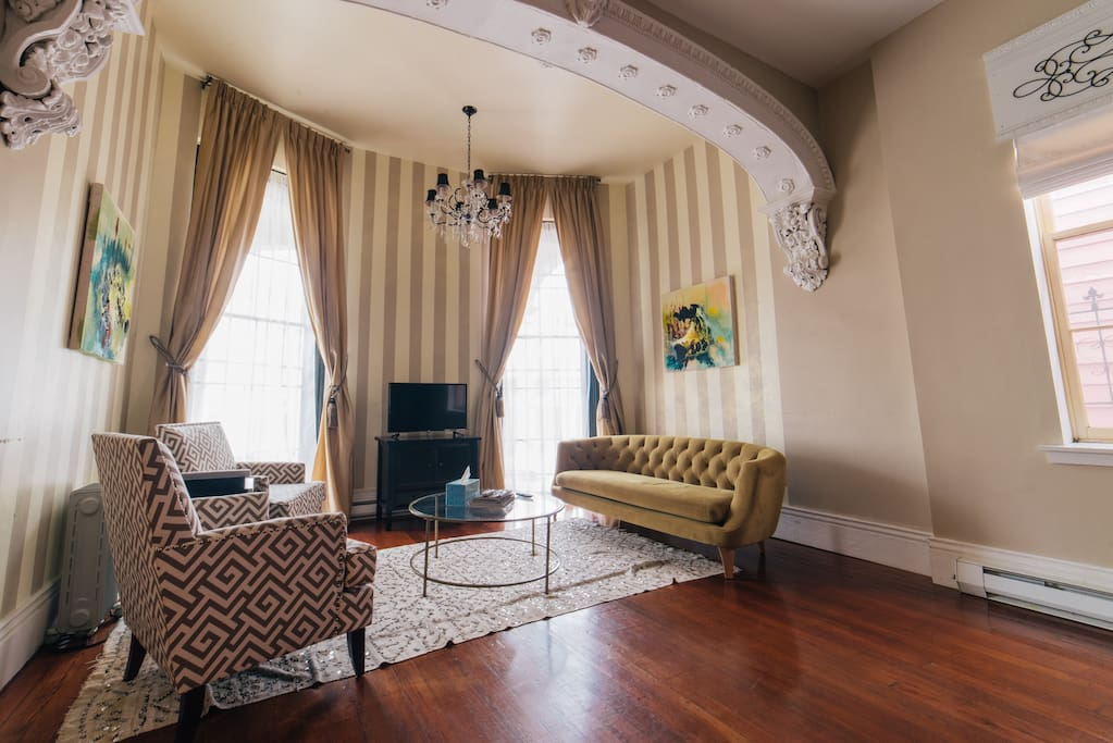 Immerse yourself in this elegant and modern living space that has amazing ceiling to floor windows, beautiful architectural details, and 11 ft ceilings.