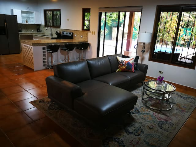 An open concept, living, dining, kitchen