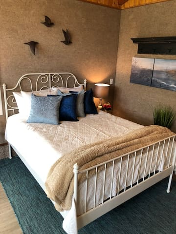 Enjoy a wonderful rest in this comfy queen bed nestled in the corner of the large Studio Suite.