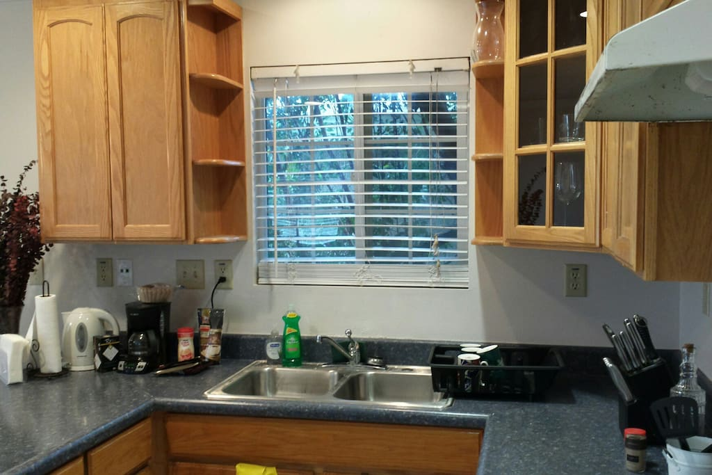 Looking out from kitchen area; stainless steel sinks.