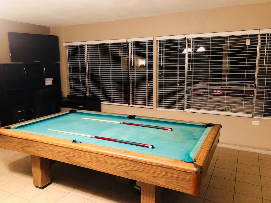 Pool table in the game room. This is where the magic happens
