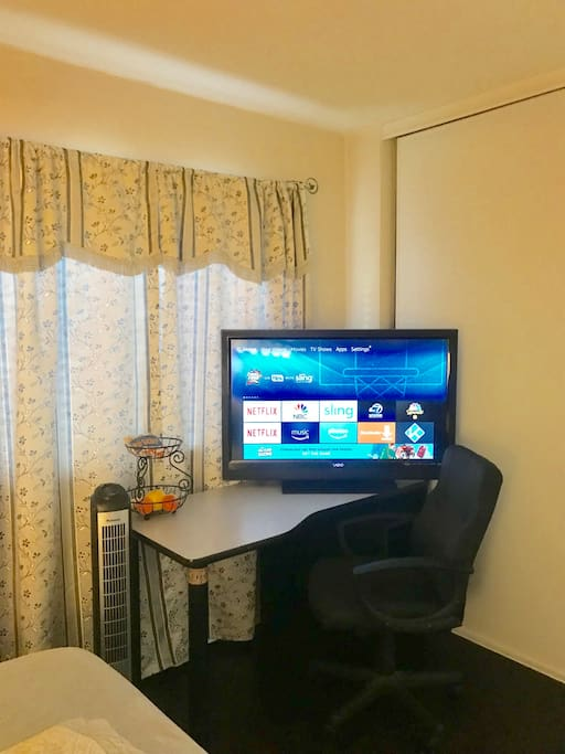 Big screen plus work station with roomy chair