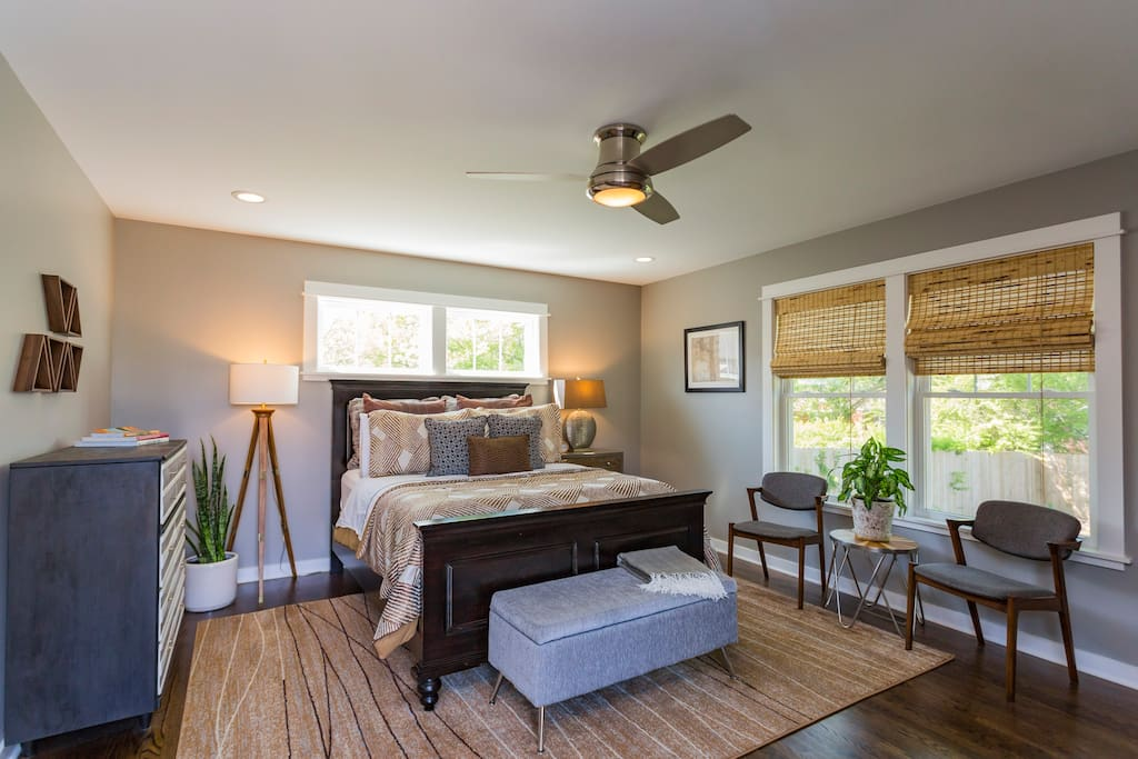 Yellowwood Rest is a suite largely composed of midcentury furniture, with ample natural light, abundant storage, and a queen-size bed.