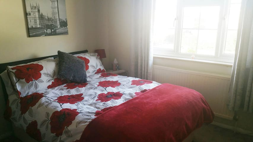 Cosy double bed with tv and tea/coffee making facilities.