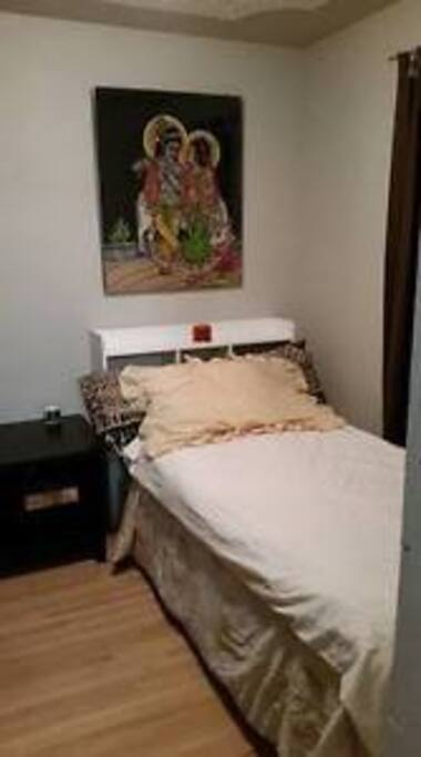 The bed is the same the space has moved to a room with  door. It is a small room very cozy. I do have many books and things in there also as it is my office. Pillow top mattress, very comfy!