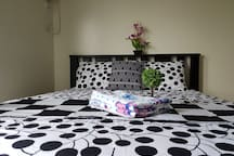 Cozy queen size bed with fresh linens