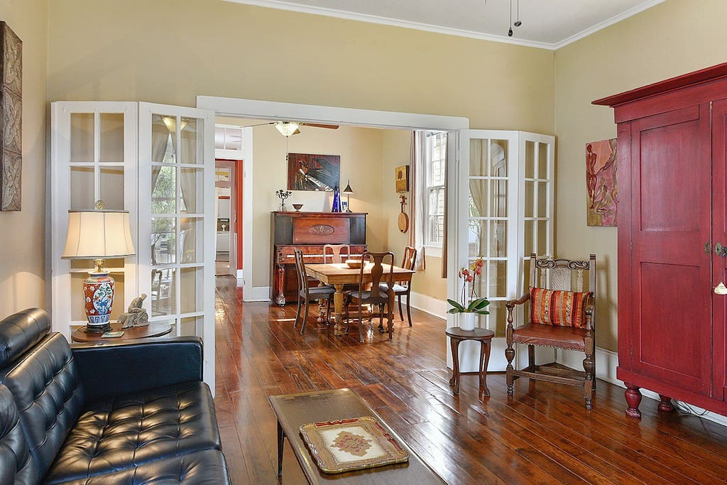 Adorable Victorian home in prime location.  View from spacious living room into dining room. Glass French doors can be closed between living and dining rooms.
