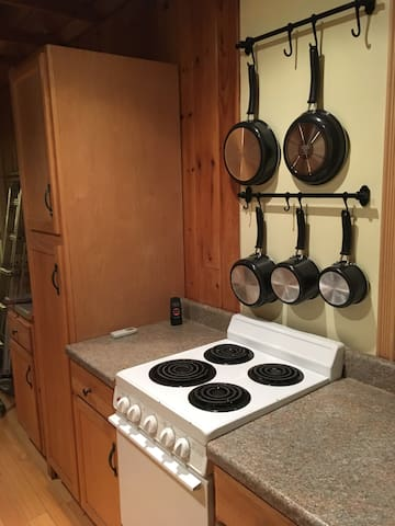 Galley kitchen with cooking facilities.