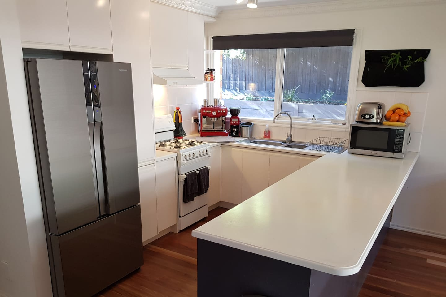 Fully stocked kitchen with gas stove and barrister style coffee machine