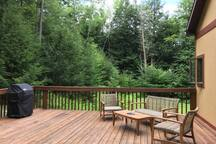 Large deck with lounge and dining areas plus grill.