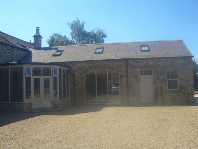 The Coach House with superb views and space.