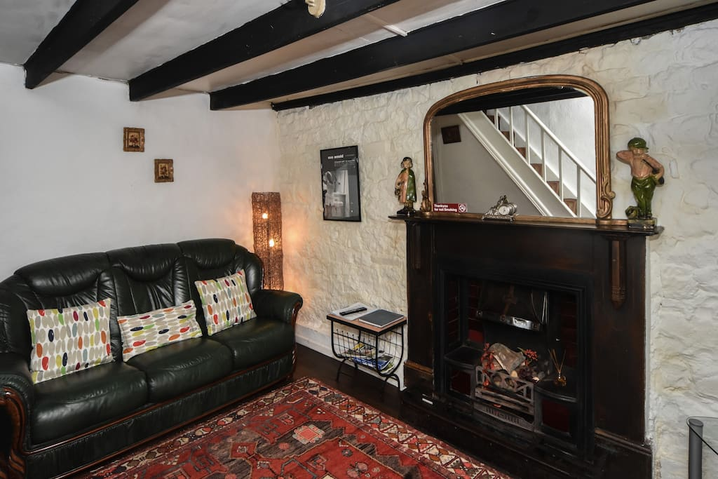 Comfortable front room. Sadly we can no longer use open fire but there is full central heating making cottage warm and cosy in colder weather.