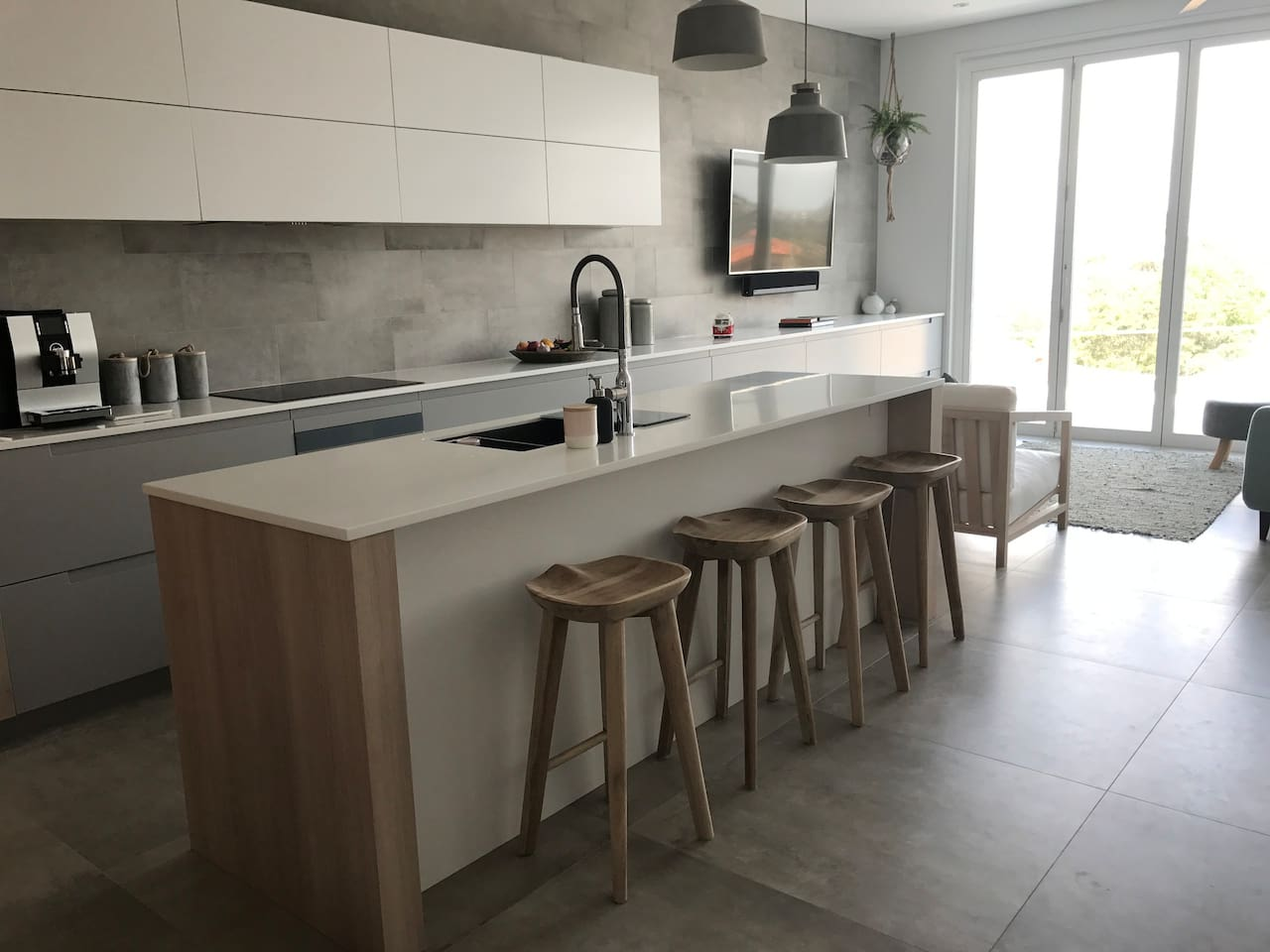 Our open plan kitchen/living area opens onto a huge balcony with ocean and city views