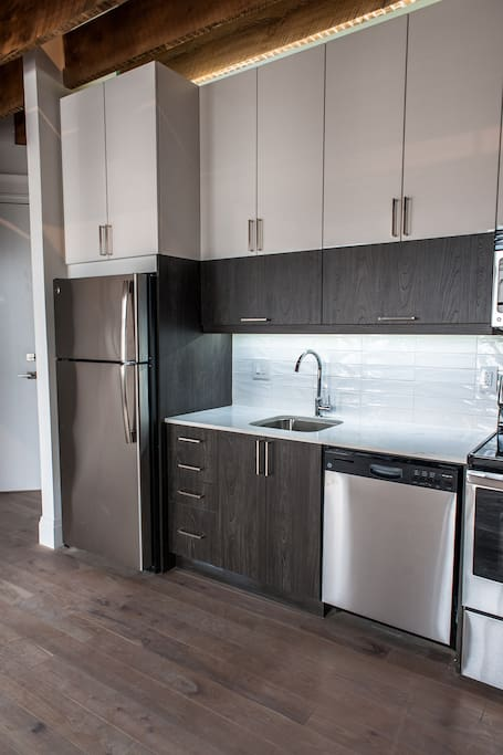 Custom Built Kitchen with Stainless Steel Appliances