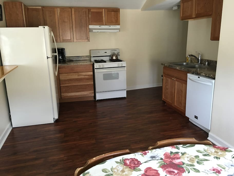 Brand new cabinets, floors and fresh paint make this home away from home very clean and welcoming.  There is plenty of storage for your groceries for the week.  Cookware and utensils, cups, plates, glasses, flatware, etc.