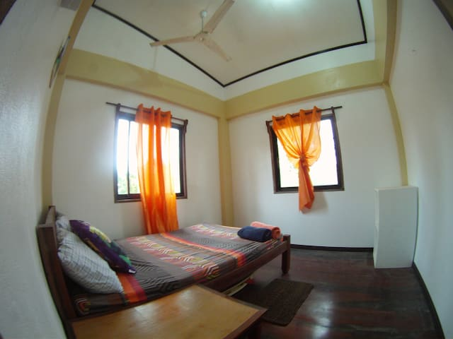 air-conditioned room with common bathroom