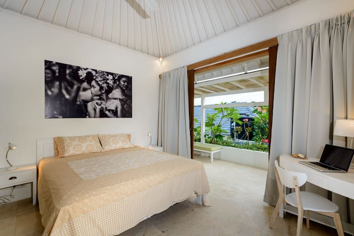 1st floor bedroom with comfortable king size bed and private balcony