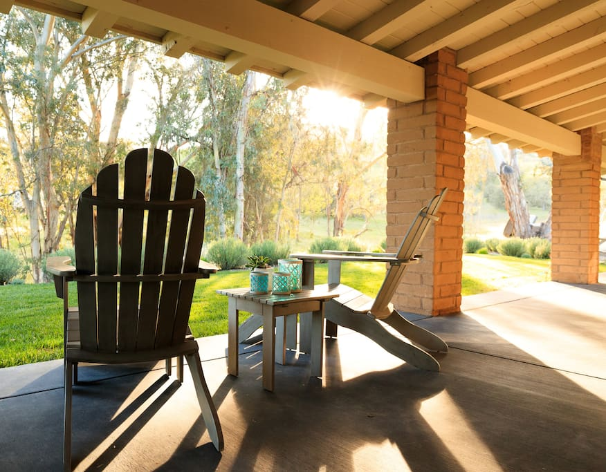 The Adirondack  chairs on the porch are a perfect place to read, visit or take a break.
