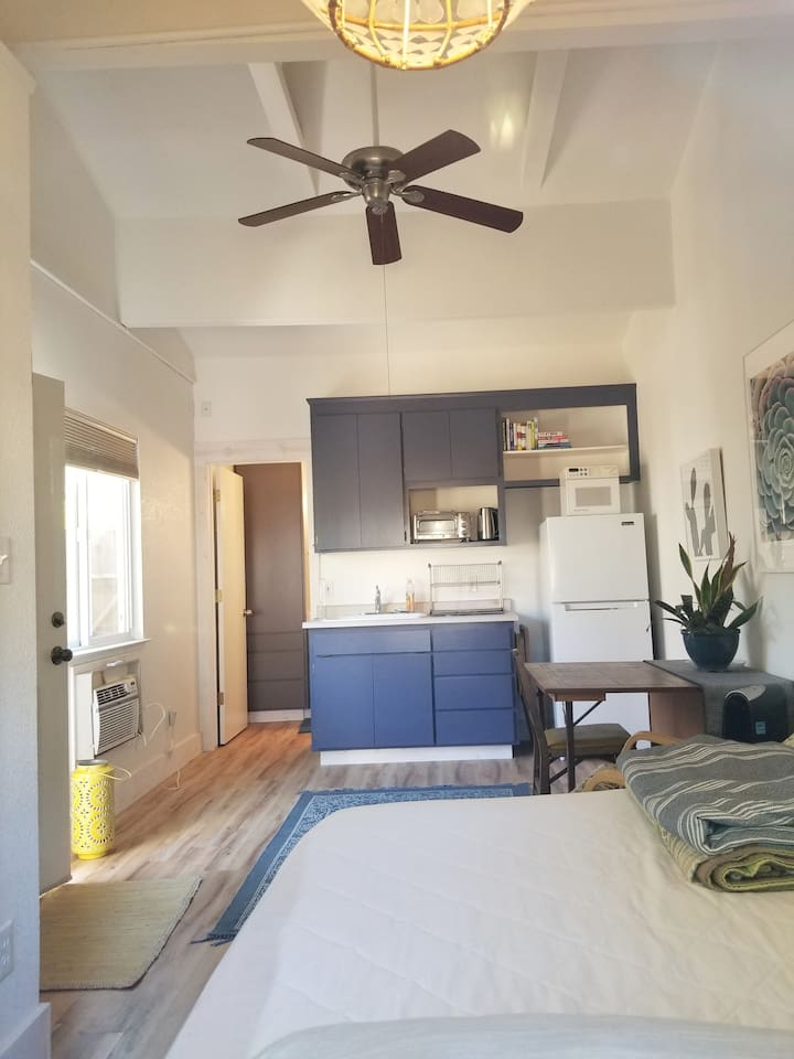 Kitchenette. Vaulted ceilings give the studio a spacious feel.