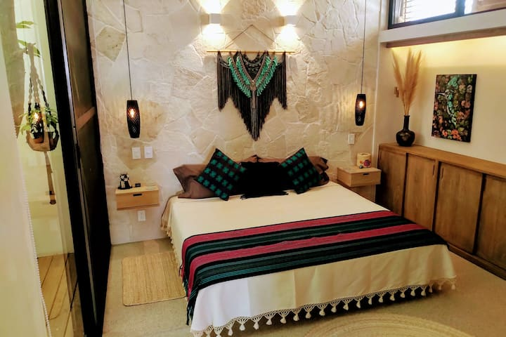 Master bedroom with king bed and en suite bathroom.