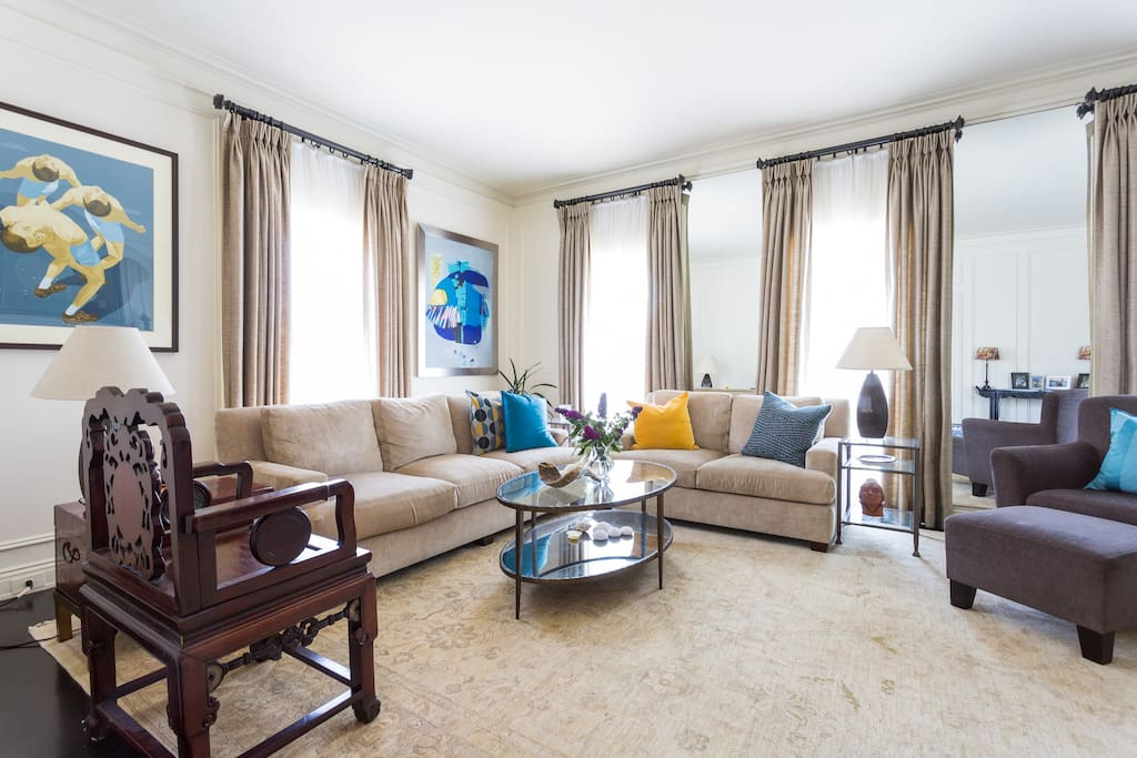 This designer decorated living room is filled with artwork and antiques and can seat 12 comfortably.